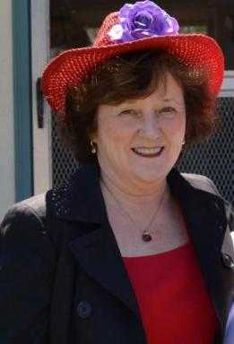 Photo of Sharon Crane with red hat